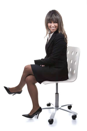 businesswoman sitting in chair isolated on white background - portrait orientation Stock Photo