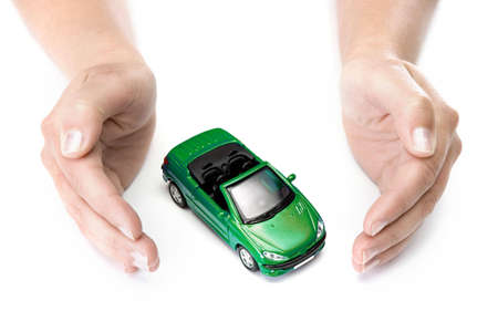 woman hands holding green car isolated on white background photo