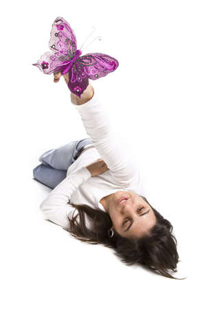 young casual woman playing with pink butterfly photo