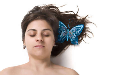 beautiful young woman with blue butterfly in the hair photo