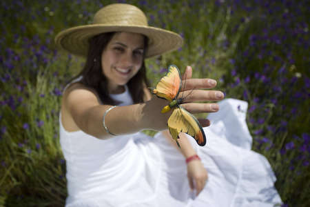 beautiful woman with white dress holding butterfly Stock Photo - 10813448