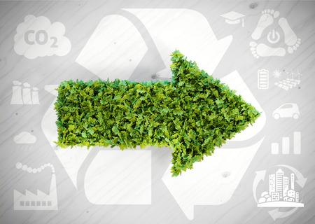kwaśne deszcze: Ecology green arrow - 3d illustration with ecology icons on grey wooden background. Zdjęcie Seryjne