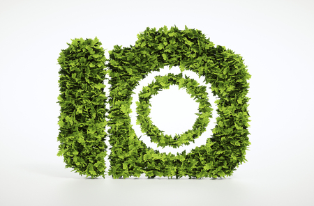 Ecology tourism concept. 3D illustration of a green camera isolated on white background. Banco de Imagens