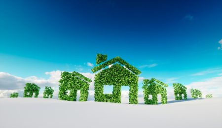 Sustainable eco village concept.  3d rendering of house symbols on winter snow field with blue sky in background.  Foto de archivo