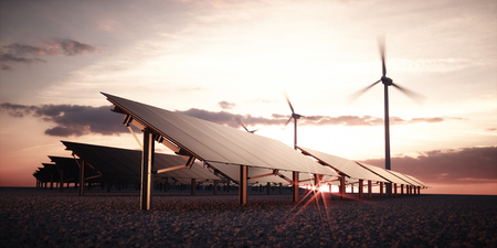 Modern and futuristic aesthetic black solar panels of large photovoltaic power station with wind turbines in background in warm sunset light. 3d rendering.