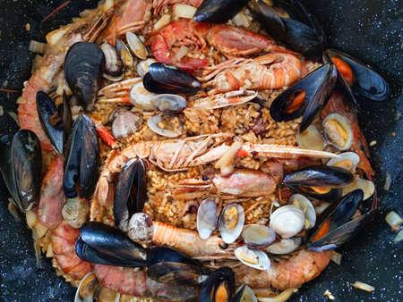 Closeup of a paella a Spanish Mediterranean rice dish originally from Valencia