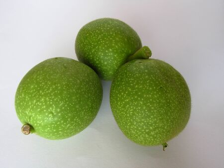 Green walnut on a white background.