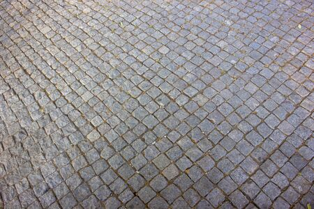Background of stone floor texture. Pavement on walkways in the park.