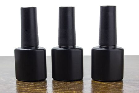 Bottle with nail polish. Black container with liquid for nail design. Photo with place for inscription.