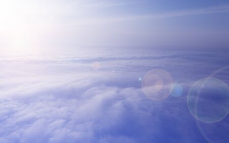 Morning sunrise over clouds, bright light and lens flare. Thick and beautiful clouds, aerial photography. Stok Fotoğraf