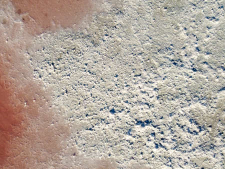 Background from salt formed as a result of drying of the pink lake.