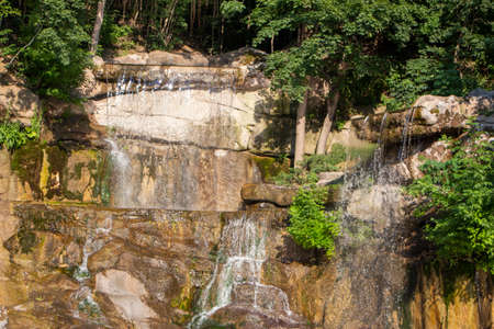 Water flowing down the rocks on a sunny summer day 免版税图像