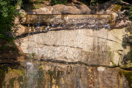 Waterfall in the park, summer sunny day 免版税图像