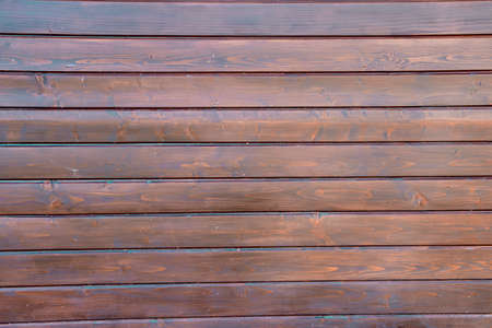 Wood texture background. The building is built of wooden boards. 免版税图像