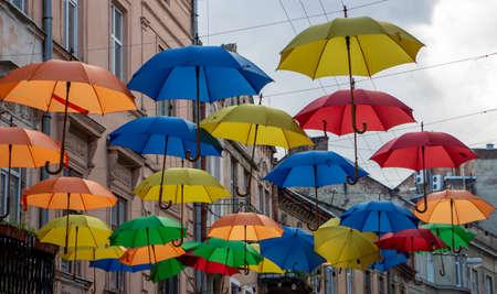 Multicolored umbrellas over the city street. Beautiful scenery.