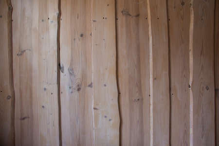 Closeup of wood background with texture and shadow.