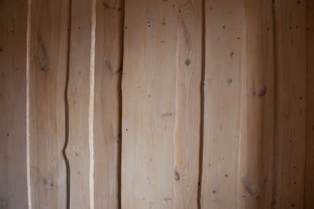 Texture of wooden boards, background with rough shadows.