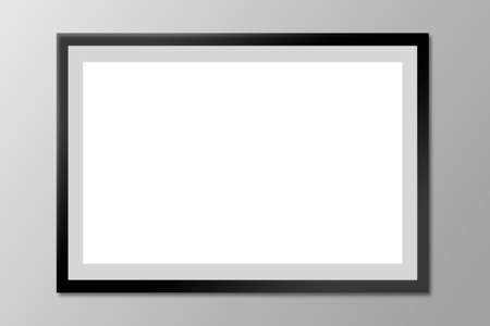 Black blank photo frame on a gray wall.