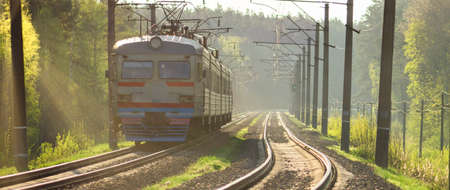 Train on railway tracks. Rails on which trains will go. Sunlight and metallic luster