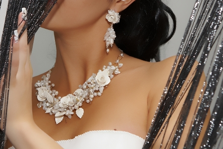 White jewelry on a beautiful bride photo