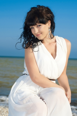 Beautiful lady of the sea in a long white dress photo