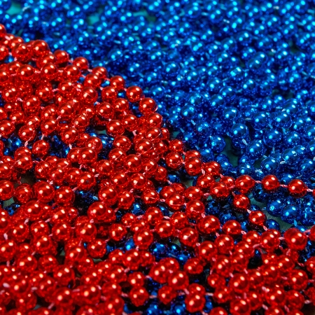 Mardi Gras beads background abstract red and blue photo