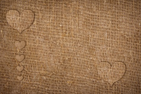sackcloth hearts over bagging textured background photo