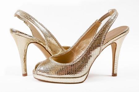 elegance: Golden elegance shoes isolated on white background Stock Photo