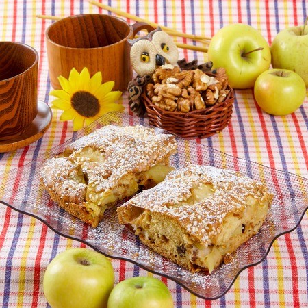 Slice of homemade apple pie with fresh apples photo