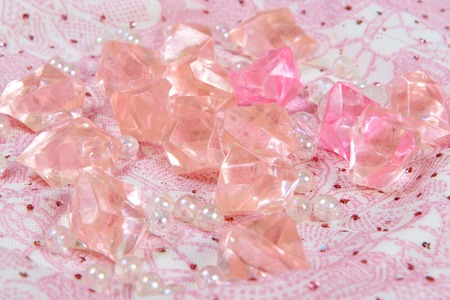 organza: Beautiful pink colorful stones on a fabric gentle background