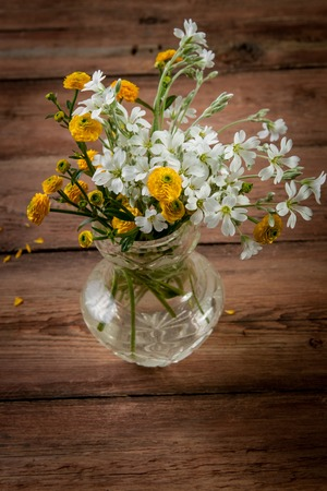bouquet  yellow  flowers on vintage wooden background photo