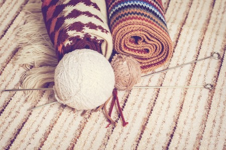 Knitting needles and yarn on rustic. Natural wool knitting background photo