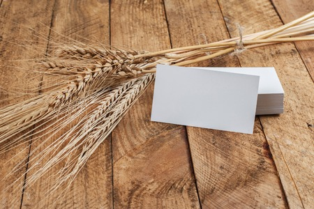 agronomist: Photo of business cards. Template for branding identity. For graphic designers presentations and portfolios. With wheat spikelets on wooden background. Subject agronomist, agriculture Stock Photo