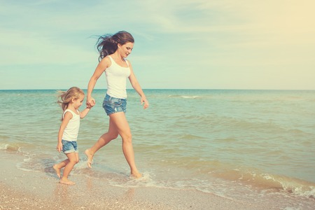 mom and daughter: Happy family. Young happy beautiful  mother and her daughter having fun on the beach. Positive human emotions, feelings, emotions.