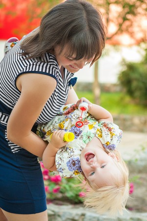 feelings and emotions: Happy family. Young mother and little daughter playing on nature. Positive human emotions, feelings, emotions.