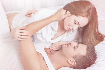 sex activity: Sexual scene of gentle and affectionate young couple in the bedroom