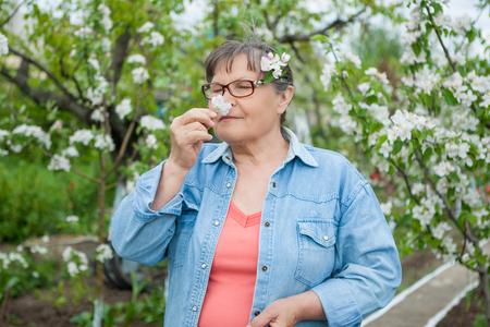 landlady: Woman in her garden. Enjoys smell flowers.