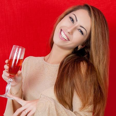 Beautiful woman with a glass of wine. Holiday. Celebratory cheerful mood