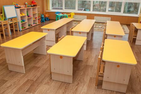Room for playing and studying kindergarten. Tables and chairs for kindergarten. Furniture,