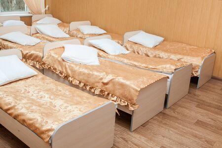 Furniture for children preschoolers. Sleeping room in kindergarten. Beds for small children