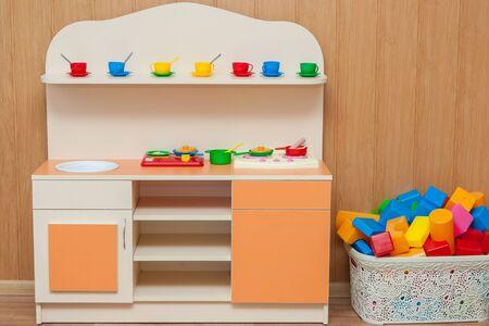 Children  furniture with plastic colorful educational blocks toys. Cupboard for preschoolers kindergarten.