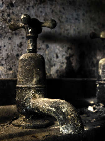 HDR detail of an old disused water tap Stock Photo