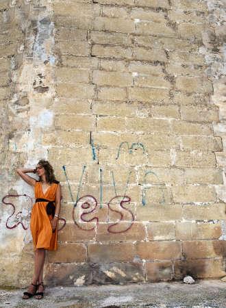 Beautiful fashion model in a dilapidated urban setting Stock Photo