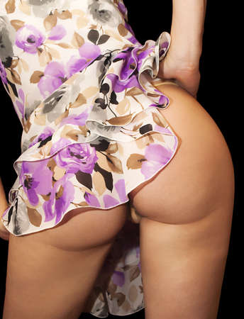 Female model showing off beautiful rear curves Stock Photo