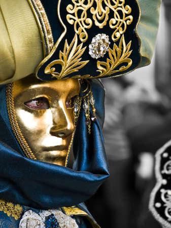 Woman wearing beautiful Venetian style masks and costumes at the International Carnival of Malta 2009