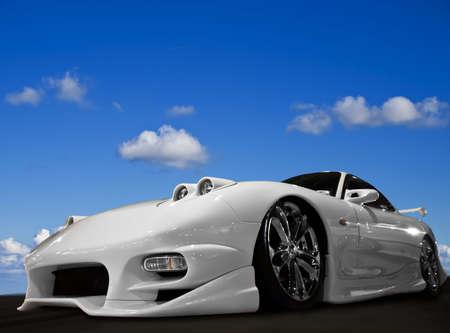 motoring: Aggressive Japanese modified car speeding along a track