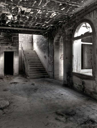 Eerie and empty hallway space in an abandoned building Stock Photo
