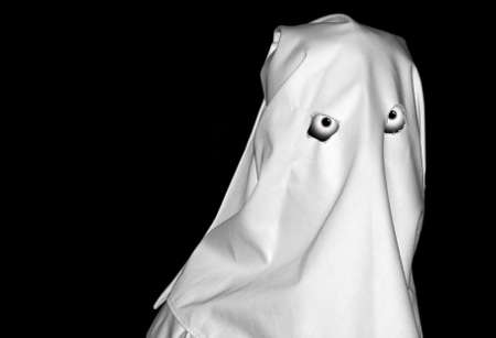 spectre: Spooky white figure over clear black backdrop Stock Photo