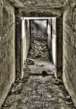 barracks: Entrance down to a derelict bunker shot in HDR Stock Photo