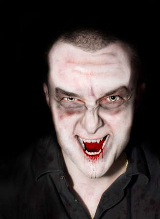 Portrait of a male vampire or creature of the night       photo
